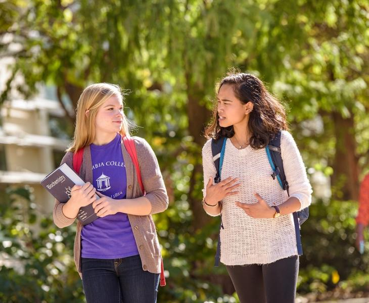Students talking on their way to class.